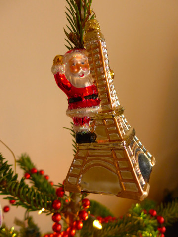 """""""Yippie,"""" says Santa, """"I made it to the top of the Eiffel Tower!"""""""