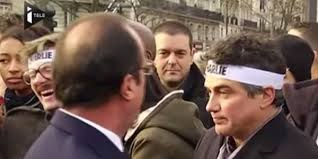 Luz's laughing hysterically after he noticed a pigeon had pooped on President Hollande's suit.